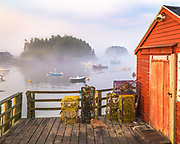 The Georgetown Town Wharf and Five Islands Lobster Co. provide one of the most picturesque setting in Maine.  On this morning a low fog hung around the islands and boats moored in the harbor as the rising sun lit everything around in a golden glow.