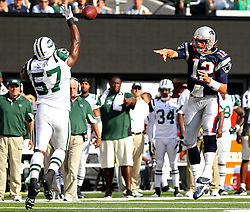 Sept 19, 2011; East Rutherford, NJ, USA; New York Jets linebacker Bart Scott (57) blocks a pass by New England Patriots quarterback Tom Brady (12) during the 1st half at the New Meadowlands Stadium.