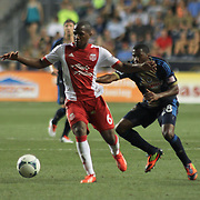 Philadelphia Union Defender Raymon Gaddis (28) attempts to apply defense on Portland Timbers Forward Darlington Nagbe (6) in the second half a MLS regular season match Saturday, July. 20, 2013 at PPL Park in Chester PA.