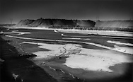 Toxic coal ice: frozen, poisonous coal waste slurry impounded in the watershed leading to the Yellow River, leaching toxins into one of China's most important sources of drinking and irrigation water, Lasengmiao, Inner Mongolia, China.