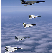 B-1B Bomber flying with F-14 Tomcats, aerial