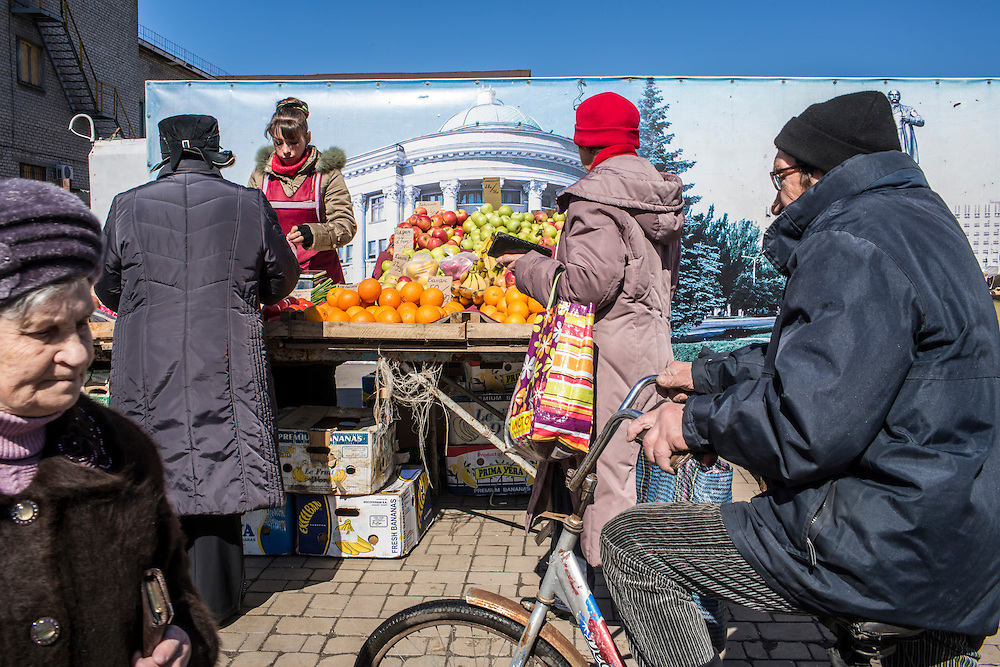 Shoppers at a market near the train station on Friday, April 10, 2015 in Donetsk, Ukraine.