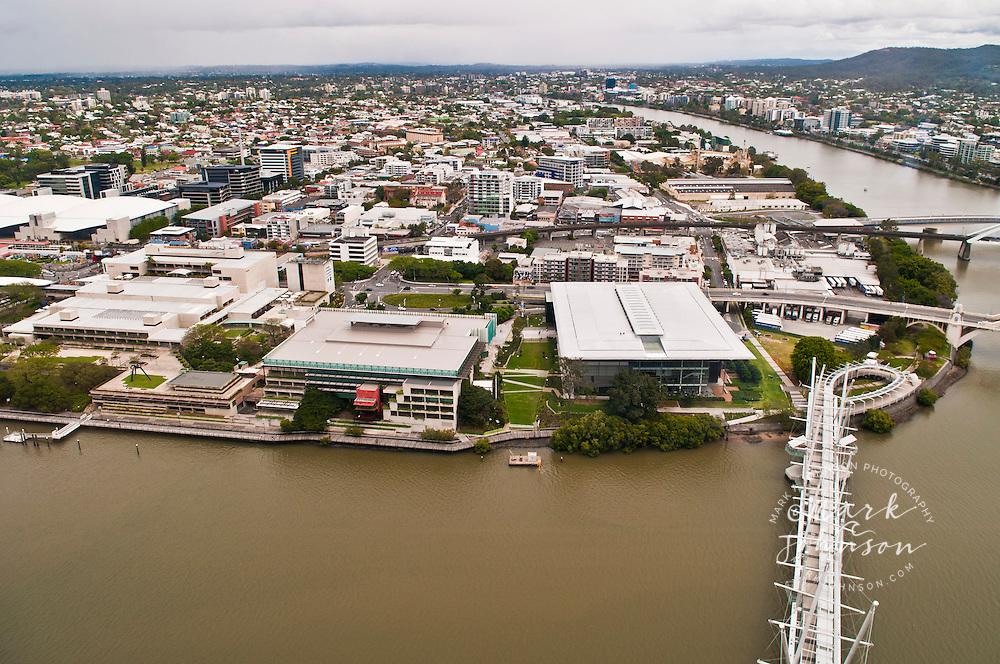 Kurilpa Bridge (fg), Gallery of Modern Art & Queensland State Library (on left of bridge) along the Brisbane River, Brisbane, Queensland, Australia