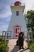 "Victoria Seaport Lighthouse Museum with Newfoundland dog ""Charley"" at entrance; Prince Edward Island, Canada."