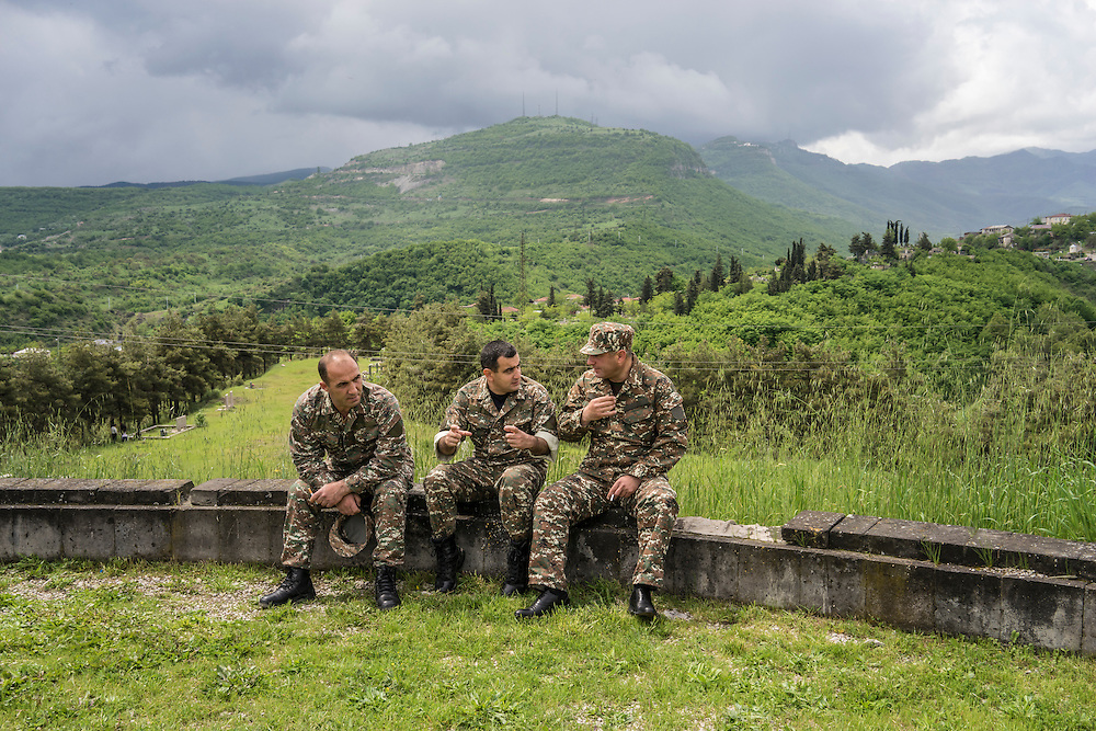 Soldiers sit down and talk with each other following a ceremony commemorating both the victory over Nazi Germany in the Second World War as well as the fall of the strategic town of Shushi to Armenian forces on Monday, May 9, 2016 in Stepanakert, Nagorno-Karabakh.