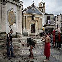 A Battente flagellates himeself in the main square of Nocera Terinese