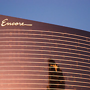 "The Encore is a part of the Wynn Las Vegas Resort and Country Club which is a luxury casino resort located on the Las Vegas Strip in Paradise, Nevada. The 2,034 room hotel had a project cost $2.3 billion. The resort covers 215 acres (87 ha)...The resort features a 74,000 square feet (6,900 m2) casino, 27,000 sq ft (2,500 m2) of retail space in ""The Esplanade"", a spa and salon, five restaurants, seven bars, as well a nightclub. The building is 631 feet (192 m) in height. The Wynn and Encore towers together have a total of 4,750 rooms."