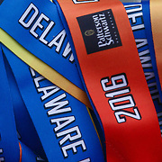 Delaware Marathon medals sit on display during 13th the Annual Discover Bank Delaware Marathon Sunday, May 8, 2016, at Tubman Garrett Riverfront Park, in Wilmington Delaware.