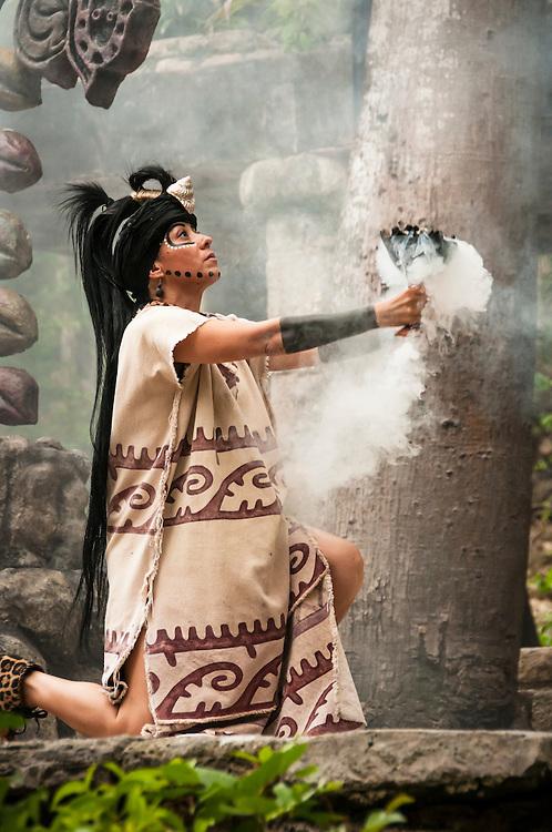 "Maya woman performing in Mayan culture show ""Los Rostros de Ek chuah"" at Xcaret park, Riviera Maya, Mexico."