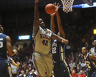 "Ole Miss center Demarco Cox (42) against Penn State forward Andrew Jones (22) at the C.M. ""Tad"" Smith Coliseum on Friday, November 26, 2010. Ole Miss won 84-71."