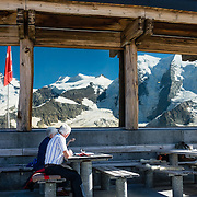 """Berghaus Diavolezza, Engadine, Switzerland, the Alps, Europe. Ride Bernina-Diavolezza lift up to Berghaus Diavolezza, optionally dining or staying overnight, for spectacular views of the Bernina Range. If not afraid of heights at Diavolezza, don't miss the scenic, rocky hike to Munt Pers which gains 265 meters over 2 km one way. Upper Engadine is in Graubünden (Grisons) canton. The Swiss valley of Engadine translates as the """"garden of the En (or Inn) River"""" (Engadin in German, Engiadina in Romansh, Engadina in Italian)."""
