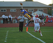 Oxford High's D.K. Metcalf (14) makes the grab but comes down out of bounds vs. Jackson Prep's Zach Williams (26) in Oxford, Miss. on Friday, August 23, 2013. Oxford won 32-20.
