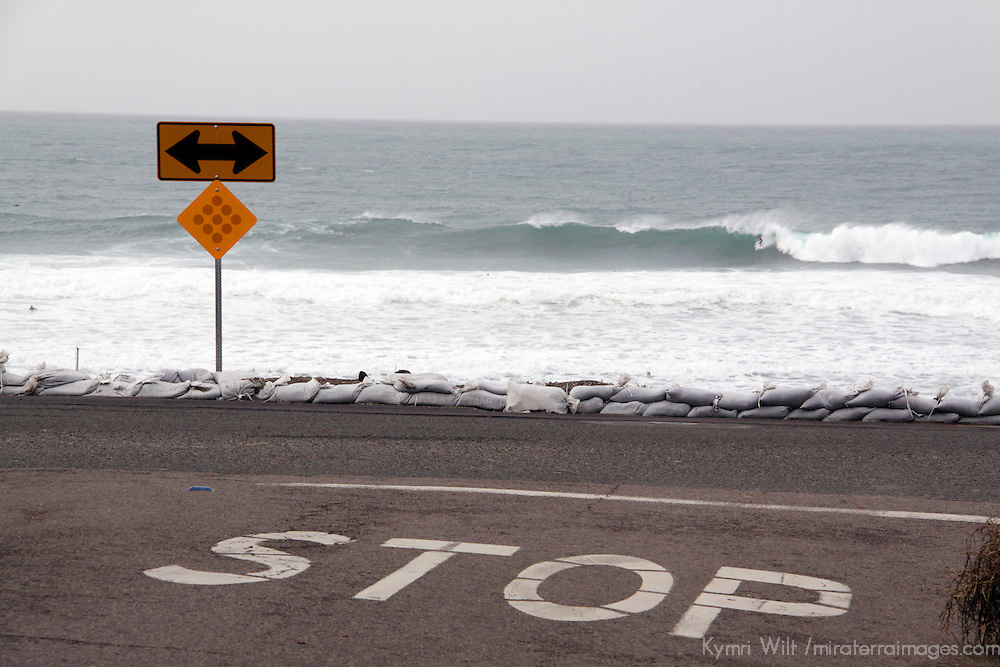 USA, California, Cardiff by the Sea. Sandbags and surf mark winter weather conditions in San Diego.