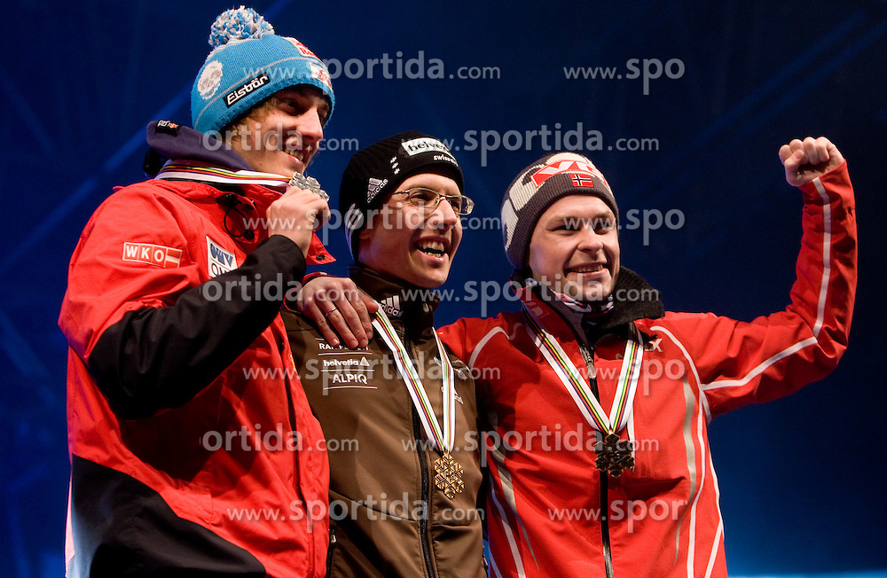 Second placed Gregor Schlierenzauer of Austria, World champion Simon Ammann of Switzerland and third placed Anders Jacobsen of Norway during medal ceremony after winning the Flying Hill Individual  at 3rd day of FIS Ski Flying World Championships Planica 2010, on March 20, 2010, Planica, Slovenia.  (Photo by Vid Ponikvar / Sportida)