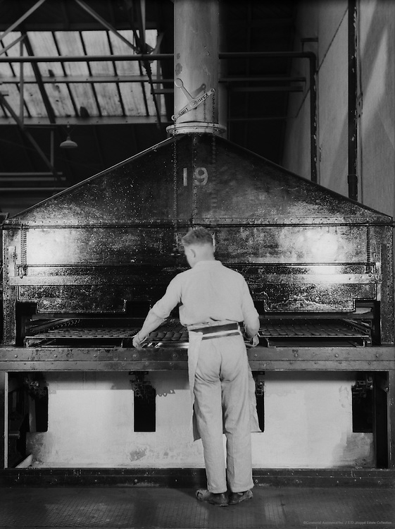 Worker Removing Biscuits from Oven, Peek Frean Biscuit Company, England, 1932