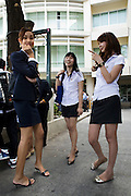 "Ladyboys Arttasit Tipsing (21) a catering student (middle) with Samathi Seangsuwan a hotel .business student (left) and Thipthantri Rujiranon (22) a comunication art student and winner of .the ladyboy beauty contest  ""Miss Tiffany Universe"" in 2005, in the rest area of Suan Dusit .university. In Suan Dusit University in Bangkok, ladyboys feel free to be themselves by getting .dressed in girls' uniforms and behaving in a feminning way. The University's policy of accepting .them as equal to other students, has made it so popular that it now has about 100 transgender .students studuing in it's faculties."