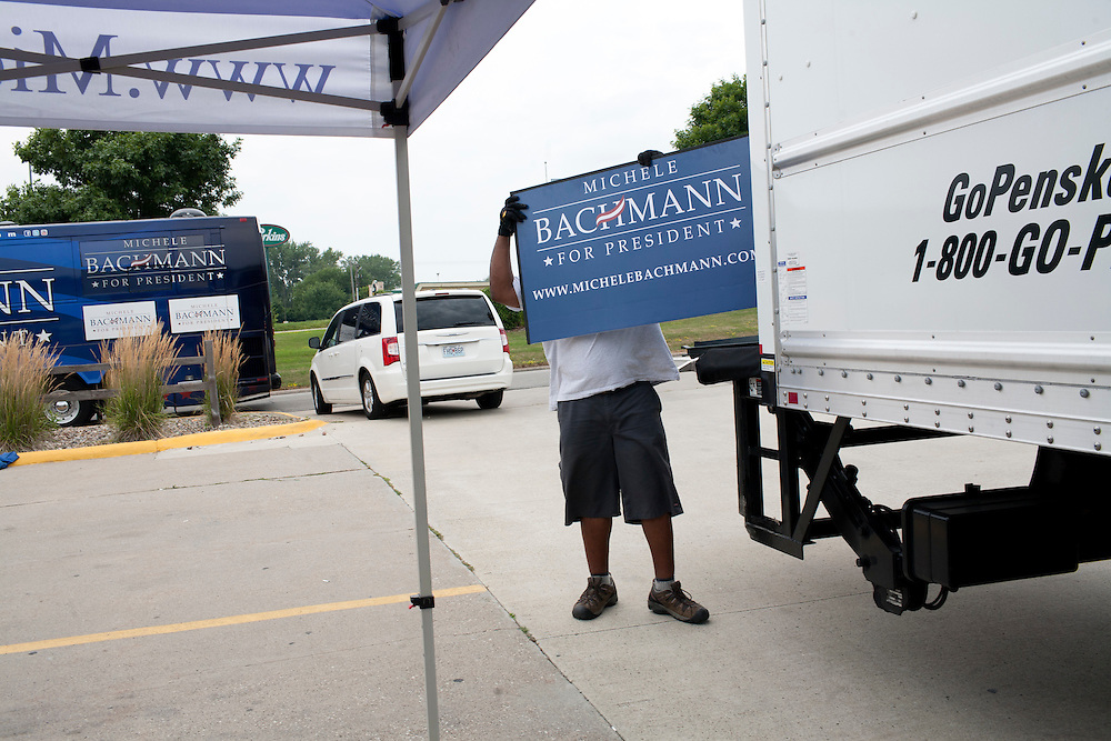 A worker loads a sign into a van following a campaign appearance by Republican presidential hopeful Michele Bachmann on Friday, August 5, 2011 in Newton, IA.
