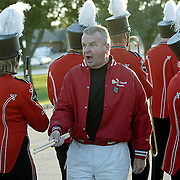 """MOC-Floyd Valley band director Steve Connell tries to get his band in formation as they prepare to march from the school to the football field on homecoming evening.  """"If they take 45 minutes to line up, Homecoming is going to be over,"""" said Connell.  """"I think he was going to be either a football coach or a band director,"""" said senior Abby Heidesch, about the sometimes strict Connell."""