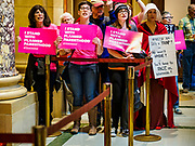 """04 MAY 2017 - ST. PAUL, MN: Women, including one dressed as a handmaid (from the novel and Hulu series """"A Handmaid's Tale""""), chant for choice and access to reproductive health care during a rally to protect women's access to health care at the Minnesota Capitol. About 50 people came to a protest to urge Minnesota State Senators to vote against two bills supported by the Republican party that would restrict access to women's health care in Minnesota. The protest was organized by  NARAL Pro-Choice Minnesota, NCJW Minnesota, and Planned Parenthood Minnesota. The Senate passed the bills but Minnesota's Democratic governor is expected to veto the legislation when it reaches his desk.     PHOTO BY JACK KURTZ"""
