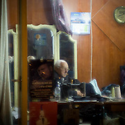 Gregory now 72 has been working in this little tailor's shop located in the area of Koukaki in central Athens for the last 60 years he tells me. He is entitled to get his pension although he feels he will have nothing to do if he retires. Image © Angelos Giotopoulos/Falcon Photo Agency