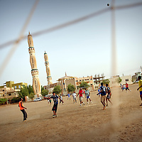 USE ARROWS &larr; &rarr; on your keyboard to navigate this slide-show<br /> <br /> Undurman, Sudan 15 April 2010<br /> Sudanese youth play football during the presidential elections in Sudan.<br /> Photo: Ezequiel Scagnetti
