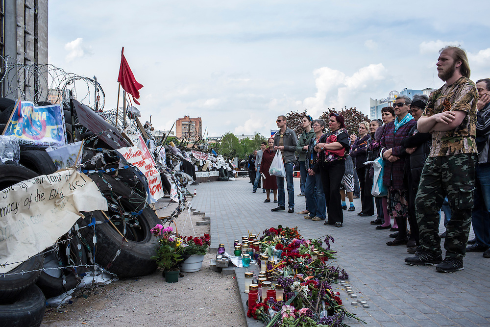 DONETSK, UKRAINE - MAY 4: People stand by a makeshift memorial to the victims of a fire in the trade union building in Odessa, Ukraine, outside the regional administration building on May 4, 2014 in Donetsk, Ukraine. Cities across Eastern Ukraine have been overtaken by pro-Russian protesters in recent weeks, leading the Ukrainian military to respond with force in some areas. (Photo by Brendan Hoffman for The Washington Post)