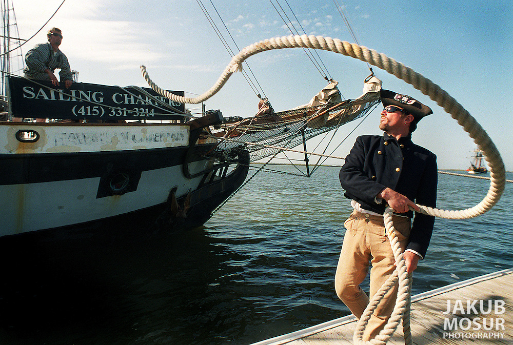 """Captain Ian McIntyre repositions a rope after docking the  Hawaiian Chieftain in Redwood City. McIntyre, of San Rafael, has been the captain of the Hawaiian Chieftain since 1992 and said """"This is a great lifestyle."""".Examiner/Jakub Mosur...March 27, 2000."""
