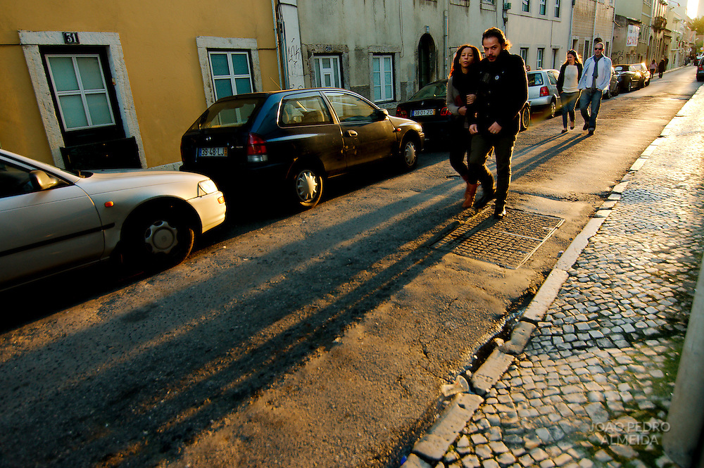 Couple walking a a Lisbon street on a sunny winter day