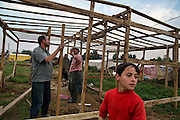 Newly arrived Syrian refugees build a shelter on a piece of land hired to them in the town of Chtaura, in the Bekaa Valley, Lebanon. There are no official refugee camps in Lebanon as the government refused to allow for their construction because of the long history of the Palestinian camps in the country. Home to 200 families. Local farmer charges each family pay $350 for a plot. More refugee arrive every night.