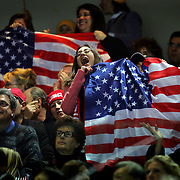 U.S. figure skating fans cheer as Emily Hughes takes the ice for the Short Program of the Women's Figure Skating competition at the Palavela ice arena in Turin, Italy on February 21, 2006. U.S. figure skater Sasha Cohen leads in the event with a score of 66.73. Teammate Kimmie Meissner is in fifth with 59.40 points and Emily Hughes is in seventh with 57.08..(Photo by Marc Piscotty / © 2006)
