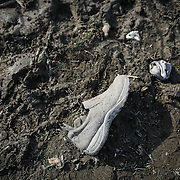 A show and socks are shown in the debris field near Oso, Wash. In the wake of Saturday's mudslide on Highway 530 in Snohomish County. Photographed on Monday, March 24, 2014 near Oso, Wash. (Joshua Trujillo, seattlepi.com)