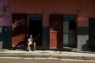 A Haitian man smokes a cigarette outside a bar near Cap Haitian's central market. Haiti, January 26, 2008.