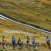SHOT 9/24/11 4:55:51 PM - A group of mountain bike racers talk about the course while racing during the Mountain Cross Race at the Oredigger MTB Challenge at SolVista Bike Park in Granby, Co. SolVista offers lift access to thousands of acres of cross-country trails, downhill mountain bike features, instruction and summer bike racing.(Photo by Marc Piscotty /  © 2011)