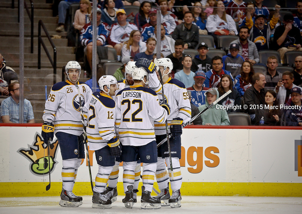 SHOT 3/28/15 8:55:37 PM - Buffalo Sabres teammates celebrate a goal by Andrej Meszaros #41 during their regular season NHL game against the Colorado Avalanche at the Pepsi Center in Denver, Co. The Avalanche won the game 5-3. (Photo by Marc Piscotty / © 2015)