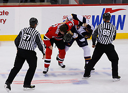 Nov 1, 2008; Newark, NJ, USA; New Jersey Devils defenseman Sheldon Brookbank (2) and Atlanta Thrashers defenseman Garnet Exelby (2) fight during the third period at the Prudential Center. The Devils defeated the Thrashers 6-1.