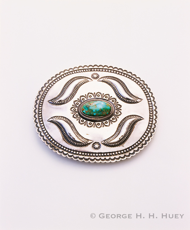 0196-1013 ~ Copyright: George H. H. Huey ~ Silver and turquoise belt buckle. Navajo repousse style. Artist: Harry Morgan, Navajo Indian, 1998. Arizona.