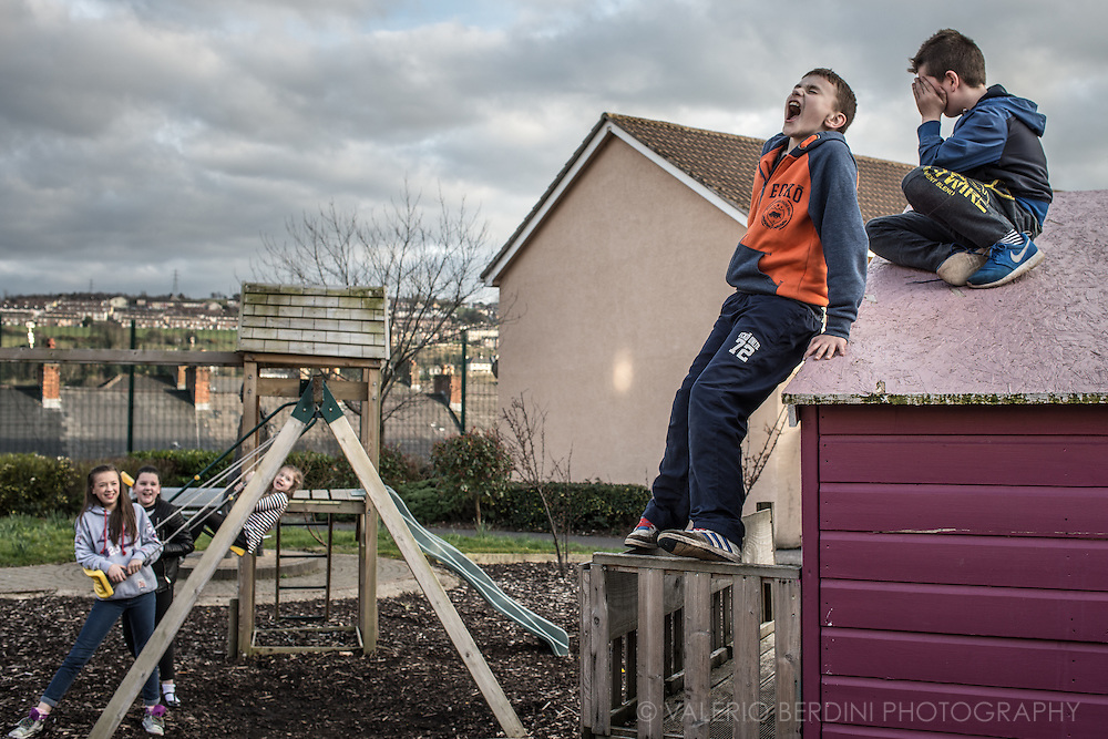 Teens play in a in a playground on a late afternoon in Londonderry's West Bank. The protestant neighbourood.