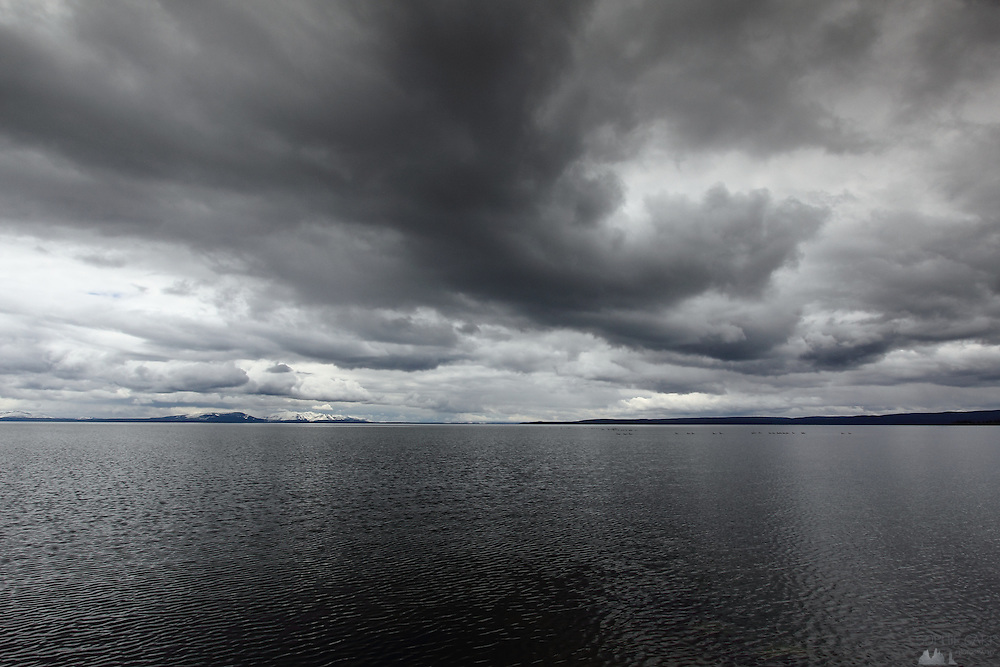 Clouds hang over the enormous Yellowstone Lake, in Yellowstone National Park, Wyoming