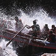 "A group of river rafters hit ""Big Drop #3"" while running the Colorado River in Cataract Canyon, Southern Utah."