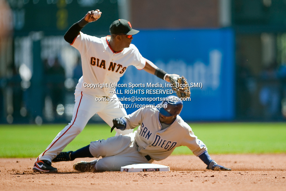 07 September 2009:  San Diego Padres center fielder Tony Gwynn (18) slides into San Francisco Giants shortstop Edgar Renteria (16) to break up a double play in the first inning during the Giants' 9-4 win over the Padres at AT&T Park in San Francisco, CA.