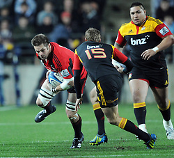 Crusaders Richie McCaw runs at the Chiefs Robbie Robinson in the Super 15 Rugby semi final match, Waikato Stadium, New Zealand, Friday, July 27, 2012. Credit:SNPA / Ross Setford