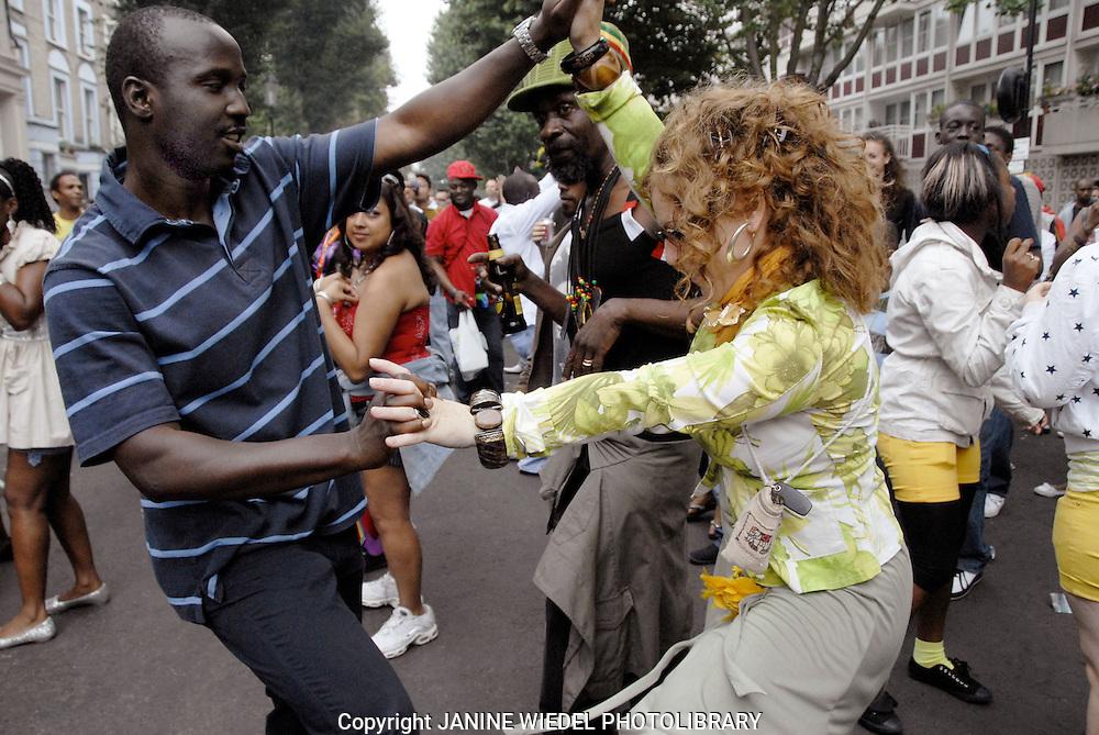 Dancing in side street Notting Hill Carnival
