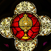 A monstrance with the consecrated host is depicted in this stained glass window at St. Francis Xavier Church in Superior.