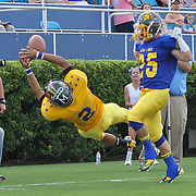 Gold Aaron Moore (2) of Indian River attempts to catch a pass as Blue's Ed Mendez (25) of St. Mark's defends in the first quarter of the 58th Annual DFRC Blue-Gold All-Star Football game Saturday, June. 22, 2013, at Delaware Stadium in Newark DE.