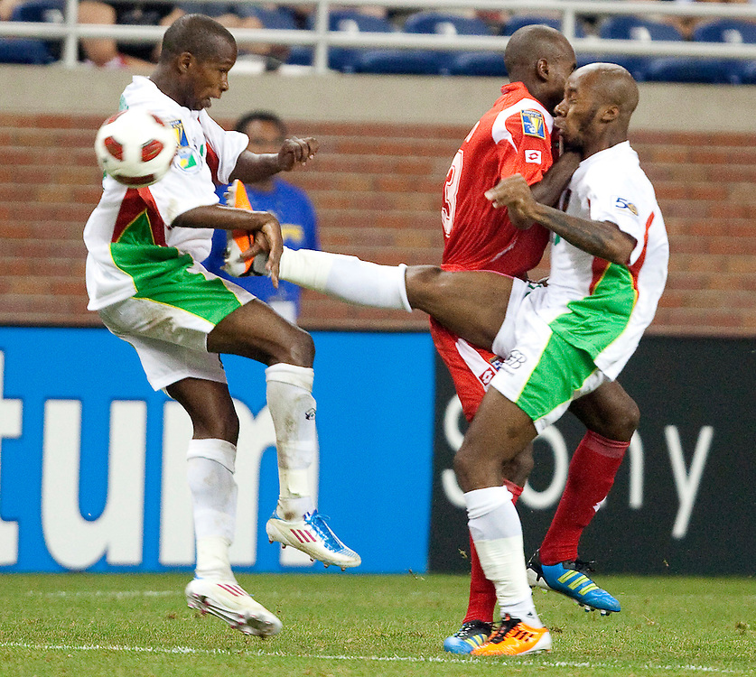 GR8011 -20110607- Detroit, Michigan,USA<br /> Guadeloupe's Thery Racon, right, collides with Panama's Adolfo Machado as he and teammate Miguel Comminges apply pressure to panama  during the final minutes of their CONCACAF match at Ford Field in Detroit Michigan, June 7, 2011. Panama defeated Guadeloupe 3-2.<br /> AFP PHOTO/Geoff Robins
