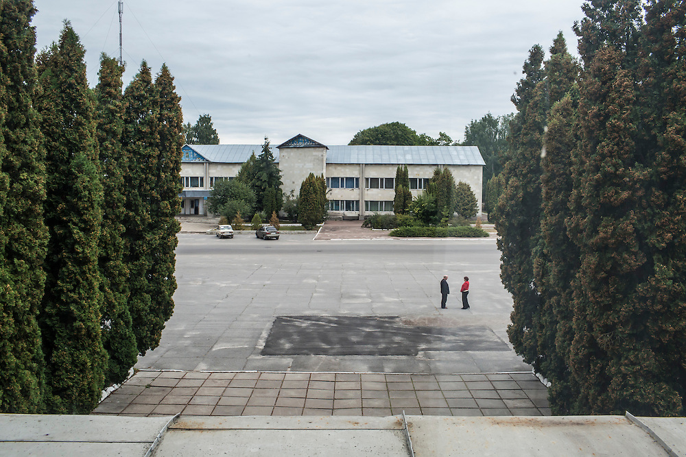 SEMYONOVKA, UKRAINE - SEPTEMBER 13, 2015: Red Square, where a patch of fresh asphalt is the only evidence of the former location of a statue of Vladimir I. Lenin, in Semyonovka, Ukraine. The statue, which was taken down from the square in the immediate aftermath of the collapse of the government of President Viktor Yanukovych in February 2014, was erected again in a new, more discreet, location two months later based in part by a petition to the city council submitted by the local Communist party. A new decommunization law has stirred criticism as being a diversion from more pressing issues of war and the economy. CREDIT: Brendan Hoffman for The New York Times