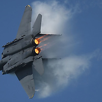 USAF F-15 Strike Eagle Jet with vapor and burners perform Acrobatic maneuvers during the air show at Fleetweek in San Francisco