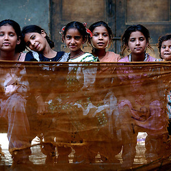 Children sit inside Dariya Khan Ghhumnat Rahat  camp set up outside a school in the state of Gujarat in Ahmedabad, India.