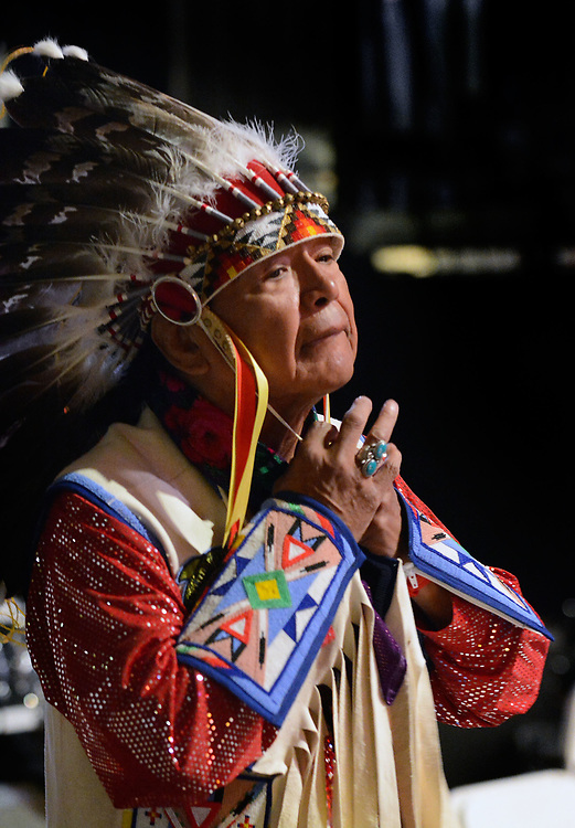 jt042817j/a sec/jim thompson/ Isaac Wak Wak of of Nespelem, WA. secures his War Bonnet as he prepares for the start of the 2017 Gathering of Nations Pow-Pow held at Tingley Coliseum.   Friday April 28, 2017. (Jim Thompson/Albuquerque Journal)