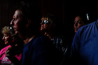 Planned Parenthood supporters wait out a rain storm in a tunnel during a rally in Tampa, FL.